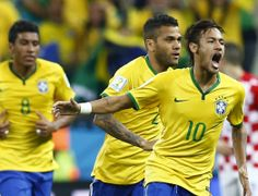 Brazil v Croatia: Group A - 2014 FIFA World Cup Brazil - (L-R) Brazil's Paulinho, Daniel Alves and Neymar celebrates a goal by Neymar during the 2014 World Cup opening match between Brazil and Croatia at the Corinthians arena in Sao Paulo June 12, 2014. (REUTERS/Murad Sezer)