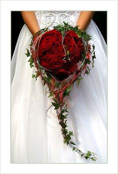 heart shaped bouquet with red roses and ivy. LOVE!!