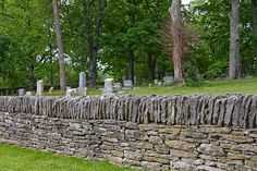 "stone walls, called ""slave walls"". were actually brought over by the irish and then built by slaves."