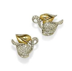 A pair of diamond and bi-color gold leaf earrings (est. $1,000-2,000) (=)