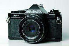 Pentax MV SLR film camera. I have one of these, it's my favourite camera. Small, light, minimal. I like to think MV = Minimalist Visionary...