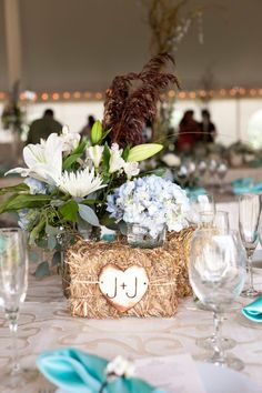 Cheerful Country Wedding Decor Ideas ★ country wedding small hay bale wooden heart and flowers centerpies lacehanky photography heuballen Country Wedding Centerpieces, Small Centerpieces, Wedding Table Centerpieces, Diy Wedding Decorations, Wedding Ideas, Wedding Country, Country Weddings, Wedding Rustic, Chic Wedding