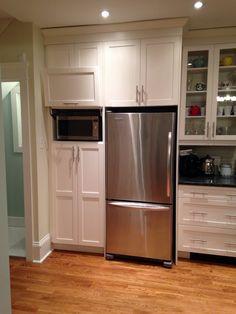 Hidden Microwave Cabinet. Golden Oak Stain On The Hardwood Floors.