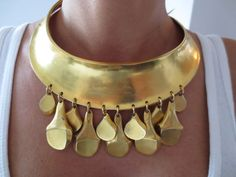 I am head over heels in love with this necklace. (VINTAGE ROBERT LEE MORRIS HAUTE COUTURE RUNWAY EARLY STUDIO NECKLACE | eBay, via Zuburbia)