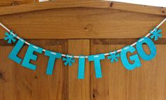 Frozen Let It Go Party Banner Blue Glitter by boxedandbowed, $16.00