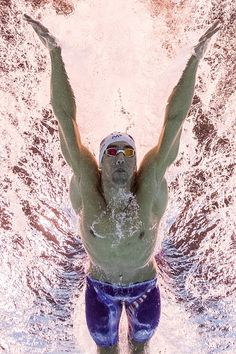 #TOPSHOT USA's Michael Phelps competes in a Men's 100m Butterfly heat during the swimming event at the Rio 2016 Olympic Games at the Olympic Aquatics...