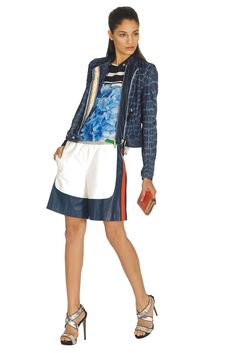 Resort 2013 Trend: The Longer Short of It (Just Cavalli's leather shorts and cotton denim jacket and Preen by Thornton Bregazzi's silk top. DKNY clutch; Just Cavalli shoes.)