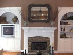 The molding/mantle for a stone fireplace (different stone and raised harth)