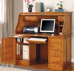 Tilden oak roll-top computer desk.