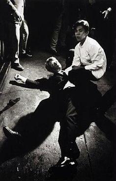 Busboy Juan Romero comforts Senator Robert F. Kennedy moments after Kennedy was shot in the Ambassador Hotel in Los Angeles, June 5th 1968.