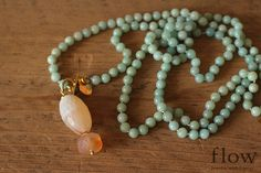 Natural Amazonite Knotted Necklace with Cherry Quartz pendant bead on Etsy, $275.00