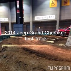 The 2014 Jeep Grand Cherokee takes on the Jeep Test Track at the 2014 Chicago Auto Show