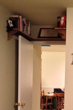 It's a book nook for that dead space above your door!