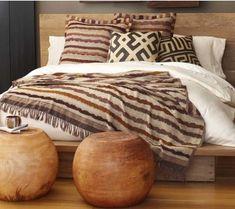 Raw Silk Striped Coverlet and Shams with some Kuba cloth pillows and natural wood accents