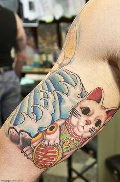 Lucky Cat Tattoo (http://www.flickr.com/photos/cheesewz/4627280325/)