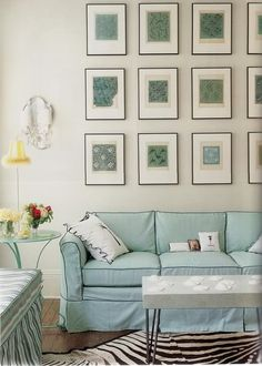 blue sofa with piping