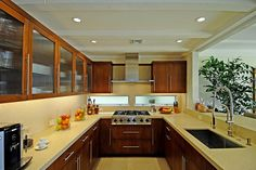 Neutral Modern Kitchen With Glass-Door Cabinets