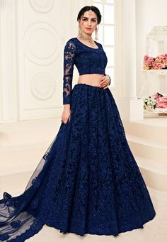Browse our collection of lehenga choli online and grab it at the best price. Shop now! This stupendous net thread work Designer Lehenga Choli. Simple Lehenga Choli, Lehenga Choli Online, Bridal Lehenga Choli, Indian Lehenga, Blue Lehenga, Net Lehenga, Indian Gowns Dresses, Indian Fashion Dresses, Pakistani Dresses