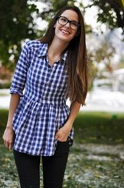 Liz from Cotton & Curls shows how she refashioned a men's button up shirt into a peplum shirt for herself. She gives it a slimmer fit through the top and sleeves, but uses the full width of the shirt at the bottom to create the gathered peplum. | Sewing | CraftGossip.com
