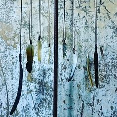 Catherine Michiels shaman feather necklaces