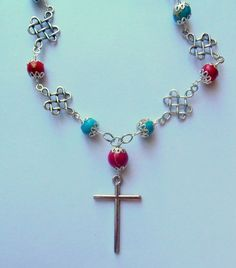Silver, red colour cross necklace with red/ turquoise sea sediment jasper.