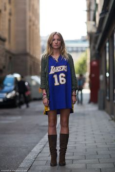 Colors a loose jersey worn as dress with boots and fitted jacket