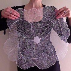 Handcut paper art by Maude White