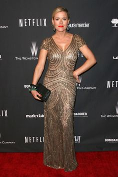Kathleen Robertson wearing M.C.L. by Matthew Campbell Laurenza bracelets to the Weinstein Company's 2014 Golden Globe Awards after party in Beverly Hills, California, 2014