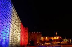 Jerusalem's Old City Ottoman Walls are illuminated in red, white and blue, the colors of the French flag.