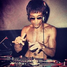 Vintage photo of Bruce Lee trying his hand at DJing. hip hop instrumentals updated daily => http://www.beatzbylekz.ca