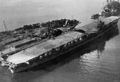 Aircraft carrier Katsuragi, after WWII. Note damage to flight deck. (Source)