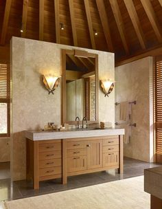 stand alone wall separating the shower with wood beam high vaulted ceiling
