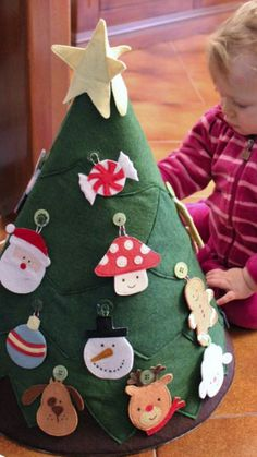 Toddlers love rearranging Christmas trees. So, give them their own to decorate. Genius, right?