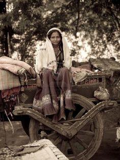 Gypsy - Roma sitting on a cart. Gypsy Life, Gypsy Soul, Santa Sara, Gypsy People, Gypsy Culture, Gypsy Women, Gypsy Living, Vintage Gypsy, Gypsy Caravan