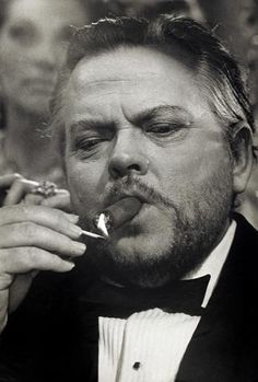 """Orson Welles With Cigar 2  by Terry O'Neill  American actor Orson Welles (1915 - 1985) on the set of the James Bond spoof 'Casino Royale', 1967.  Limited Edition Silver Gelatin Signed and Numbered  12"""" x 16"""" / 16"""" x 20""""  20"""" x 24"""" / 20"""" x 30""""  24"""" x 34"""" / 30"""" x 40""""  40"""" x 60"""" / 48"""" x 72""""  For questions or prices please contact us at info@igifa.com  IGI FINE ART"""