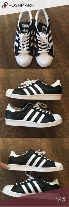 Adidas Originals black leather Superstars Worn indoors twice. Great condition- black leather with white stripes adidas Shoes Sneakers