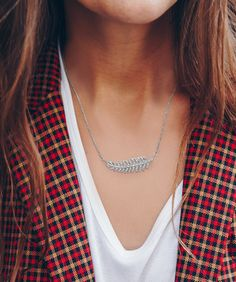 We love this Sterling Silver Leaf Necklace as this week's feature for our Fall Fashion Series. #QualityGold #FallFashion #FashionTrends #Trending #Jewelry #SterlingSilverJewelry #MixedMetals #LeafNecklace #Accessories
