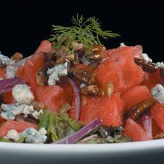 Watermelon Salad with Sugared Pecans and Blue Cheese........  The combination of watermelon with blue cheese may seem strange at first – but with one bite, the salty-sweet contrasts will be immediately understood...and loved!