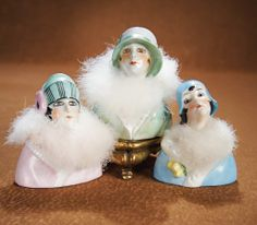 Three German Porcelain Powder Puff Flappers with Hats. http://Theriaults.com/