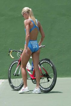 Not your stringy weekend cyclist. Tough looking chick.
