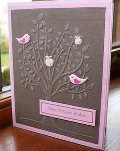handmade birthday card ... embossing folder tree with sweet punched birds and aapples in a tree ... mostly soft brown with pink mat, die cuts and sentiment ...