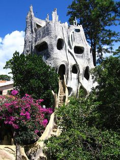 Located in Dalat, Vietnam the Crazy House, formerly known as Hang Nga Villa, was designed by architect Dr. Dang Viet Nga.  Photo by Alasidir.