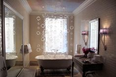 Coffinier Ku Designs, Ltd.'s used glass bubbles for whimsy in the bathroom of a designer show house.