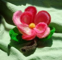 a needle felted flower brooch