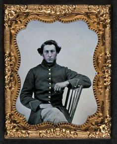 Unidentified soldier in Union frock coat.  Ninth-plate tintype, hand-colored ; 6.3 x 5.2 cm. (plate)