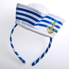 One Sassy Sailor. Wear this Anchor Sailor Hat Fascinator to put a stylish spin on a classic costume. This white, blue, and gold headpiece will get your extraordinary sailor costume noticed during your Halloween celebration. One fascinator per package. Mini sailor hat is approximately 2¼″ tall. White had with sewn on blue ribbon and an embroidered gold anchor. Fabric and ribbon wrapped headband for a comfortable fit. Make your sailor costume memorable with fun and sassy accessories. Stoc...