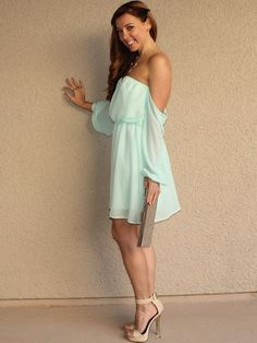 """Chiffon Off Shoulder Peasant-Style Dress  Color: Mint (chiffon) 100% Polyester Sheer sleeves Lined Elasticized chest and waist Measurements on Model (small) 9.5"""" long top hem to waist 18"""" long waist to bottom hem"""