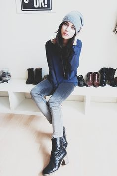 Beanie, boots, blue top, washed-out jeans, boots