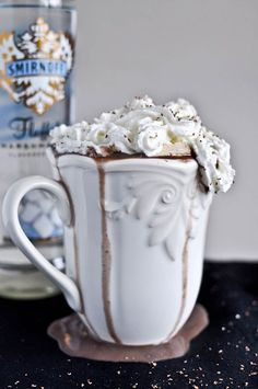 """Grown Up"" Hot Chocolate (Hot chocolate, marshmallow vodka and homemade Bailey's marshmallows) Level of Boozy: Staring into the bottom of the cup and not talking to anyone because the best thing that's ever happened to you is gone.How to found here http://www.howsweeteats.com/2011/11/grown-up-hot-chocolate-with-homemade-baileys-marshmallows/ 