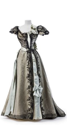 Two-piece ball gown with black tulle overdress, by Jean-Philippe Worth, c. 1895. Photo ©: Stephan Klonk / Kunstgewerbemuseum, Staatliche Museen zu Berlin. Via Europeana Fashion.